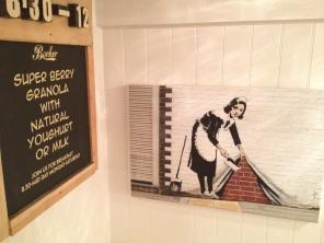 Coffee shop Banksy print.
