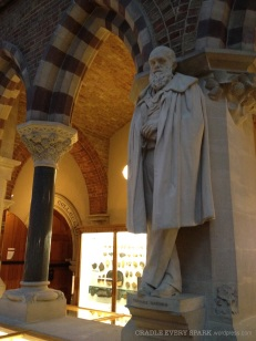 Charles Darwin, watching over his domain. Each of the columns represents a different stone found in the UK.